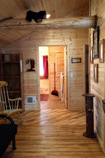 Cabin 1 (Cedar) living room facing the hallway and bathroom.