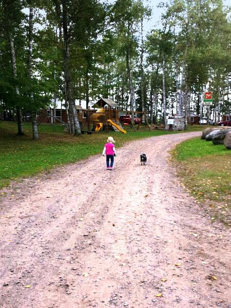 Girl walking dog at Peninsula Pines Resort.