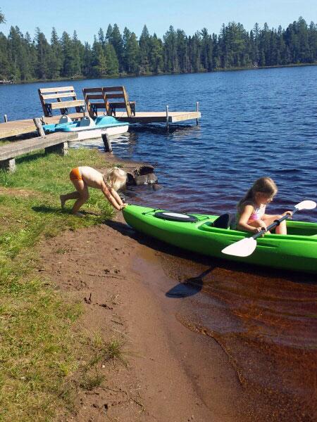 Girls kayaking on Little Muskie Lake near Spenser, WI.