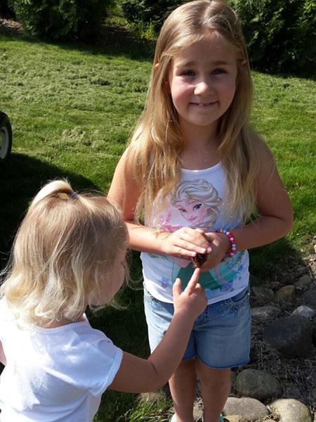 Girls petting a chipmunk at Peninsula Pines Resort.