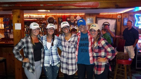 Female friends posing at the Lodge at Peninsula Pines Resort Lodge.
