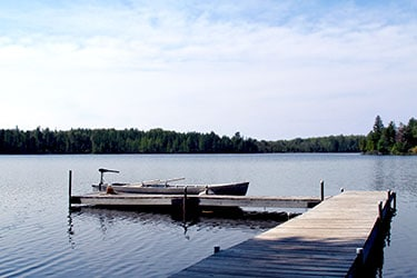 Little Muskie Lake boat pier in Wisconsin vacation resort near Mercer Wisconsin.